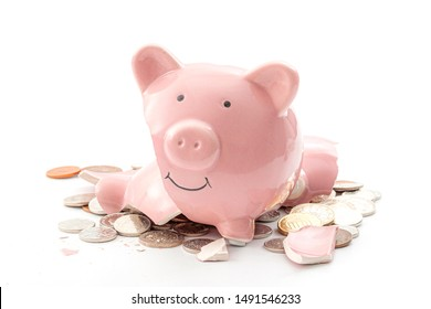 Break the bank, economic downturn and bankruptcy concept theme with a broken piggy bank and scattered coins isolated on white background