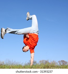 Break dance on grass. Man in red t-shirt. To see similar images, please VISIT MY GALLERY.