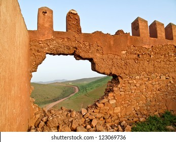 Break down the wall, the freedom is outside / Broken wall and road to freedom. (morocco)