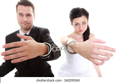 Break up ending relationship between husband and wife. Couple in divorce crisis. Man woman unhappy holding hands in handcuffs. Isolated