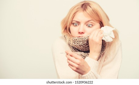 Break fever remedies. Seasonal flu concept. Woman feels badly. How to bring fever down. Fever symptoms and causes. Sick girl with fever. Girl sick hold thermometer and tissue. Measure temperature.