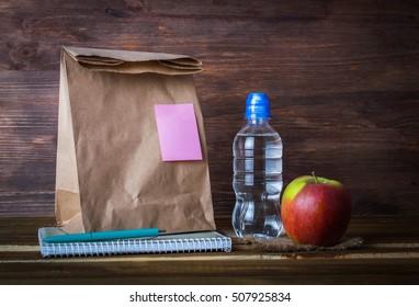 A break for food, school breakfast, a working lunch. On a wooden background.