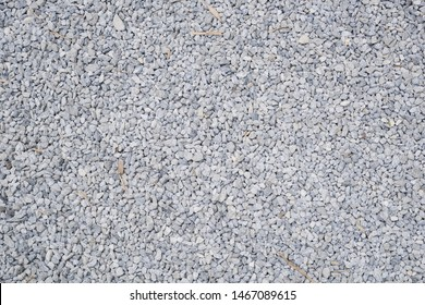 Break stone background. Road gravel. Gravel texture. Crushed Gravel background. Piles of limestone rocks. Asphalt stones on construction site