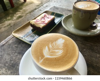 Break time by cups of hot coffee and beautyful cake.