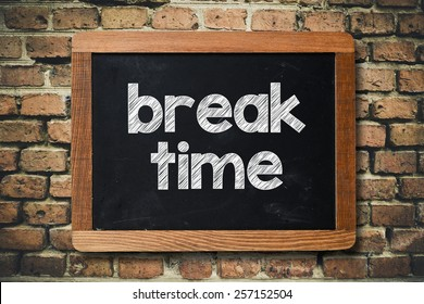 Break time on Blackboard. Break time on Blackboard on bricks wall
