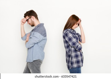 Break up, divorce. Upset young couple standing back to back after quarrel, isolated white background, copy space