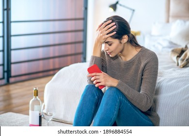 Break up. Young woman feeling stressed and drinking alcohol