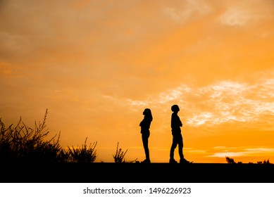 Break Up,Bad relationship,Anger,unhappy, concept.Silhouette of anger of couples love who are quarreling (argument) and standing back to back with sunset background in Thailand
