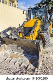 Break. Yellow excavator with shovel at construction site