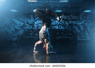 Breakdance motions, performer in dance studio