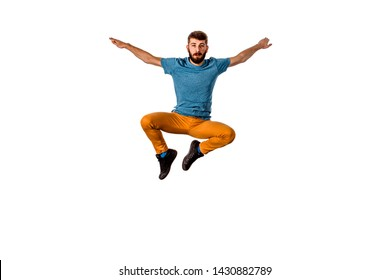 Breakdancer does expressive move and jump high isolated on white