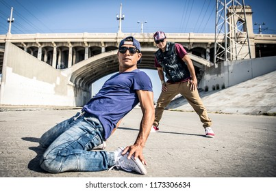 Breakdancers performing in a water duct