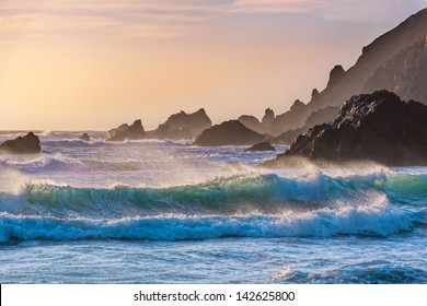 Breakers roll in at sunset on Pfeiffer Beach in Big Sur, California.