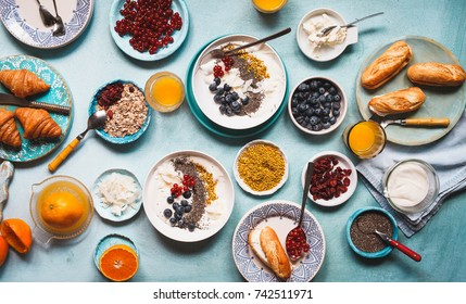 Breakfast abundance meal variety healthy breakfast oatmeal chia seeds honey pollen sandwich cream cheese brunch overhead table