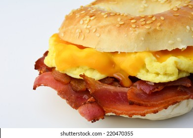 Breakfast bagel with scrambled eggs, cheese and bacon. Breakfast sandwich. Isolated. Close up.