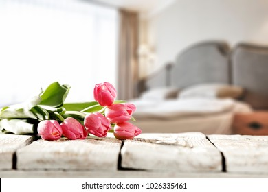 Breakfast in bed in a beautiful room and a wooden table for an advertising product or text