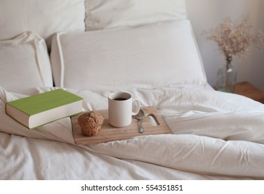 Breakfast in bed with a book