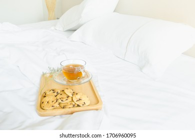 Breakfast in bed with cookies and coffee