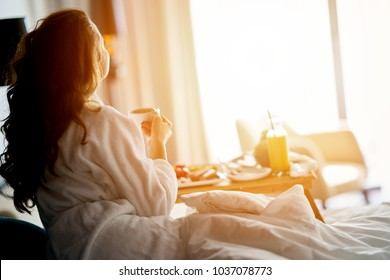 Photo of Breakfast in bed, cozy hotel room. concept