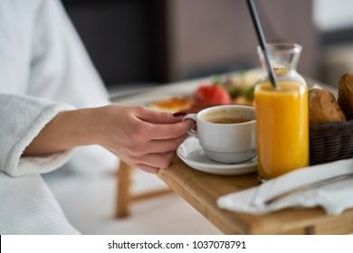 Breakfast in bed, cozy hotel room. concept