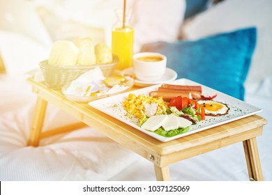 Breakfast in bed, cozy hotel room. concept