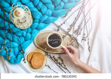 Breakfast in bed with cozy merino wool blanked. Cup of coffe and cookies