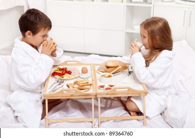 Breakfast in bed - kids having a meal in the morning
