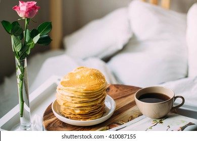Breakfast in bed. Woman morning concept