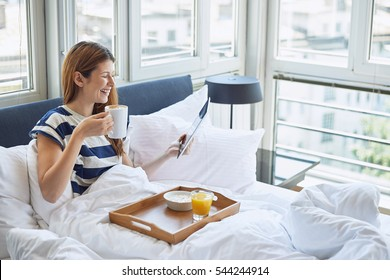 Breakfast in bed for young beautiful woman