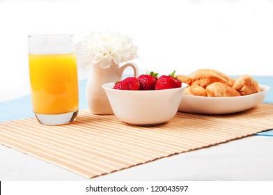 Breakfast with berries,orange juice and croissant, early breakfast