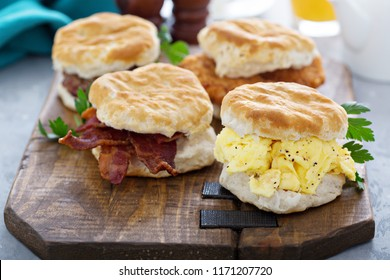 Breakfast biscuits with soft scrambled eggs, bacon, sausage and chicken