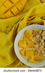 Breakfast bowl with cereal, mango and flax seeds
