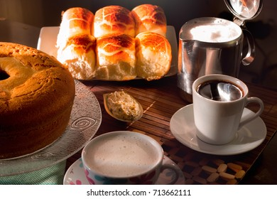 breakfast in Brazil with breads milk and fresh cake on a table