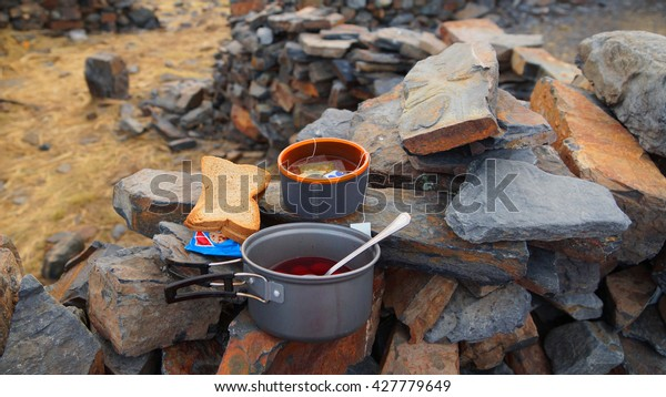 Breakfast of bread, tea and soup in the camp in the mountains