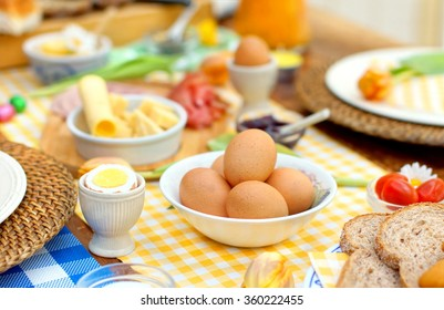 breakfast or brunch table setting  full of healthy ingredients for a delicious easter meal with friends and family around the table