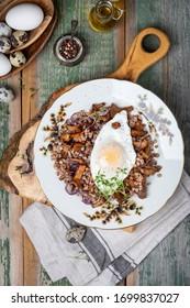 Breakfast Buckwheat porridge with wild mushrooms chanterelles and egg