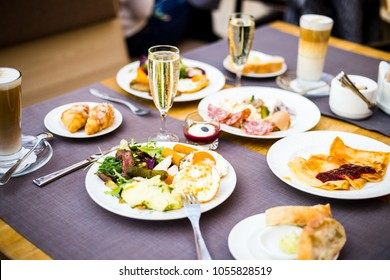 Breakfast Buffet Concept, Breakfast Time in Luxury Hotel, Brunch with Family in Restaurant, Glass of Champagne with Tasty Food on a Plates