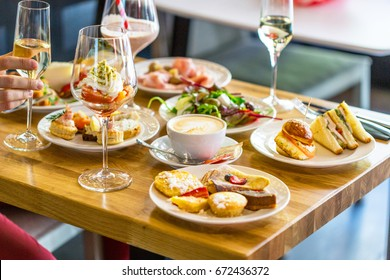 Breakfast Buffet Concept, Breakfast Time in Luxury Hotel, Brunch with Family in Restaurant, Mans Hand with Glass of Champagne