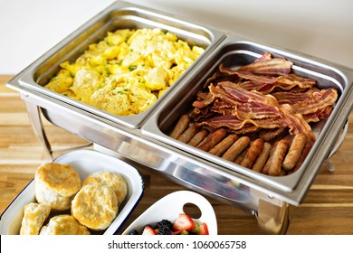 Breakfast buffet with scrambled eggs, sausage and bacon