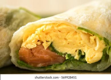 breakfast burrito with cheese, eggs and heirloom cherry tomato, salmon