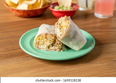Breakfast burrito made with refried beans and eggs served in a flour tortilla. Mexican food for breakfast.