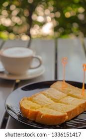 Breakfast butter bread and coffee
