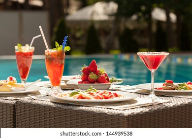 Breakfast by the pool. Light snacks, fresh strawberries, fruit smoothies.