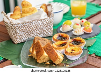 Breakfast of cake and sweets pastel de natas, Traditional portuguese food.