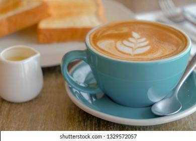 Breakfast cappuccino coffee and bread