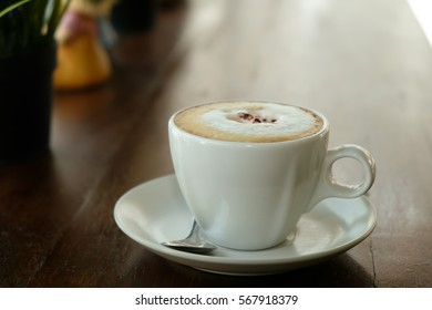 Breakfast, Cappuccino coffee on wooden table