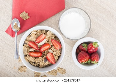 Breakfast, cereal with fresh strawberries and milk