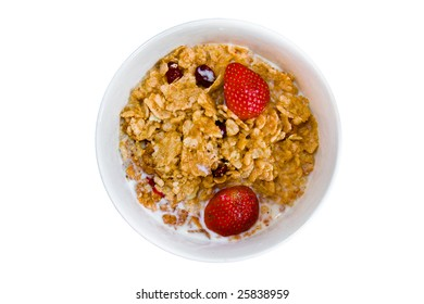 Breakfast cereal with strawberries and milk isolated on a white background