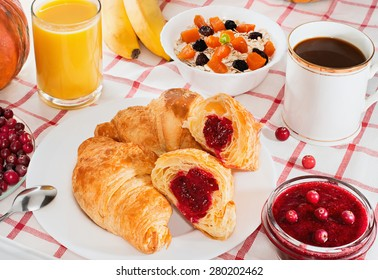 Breakfast with coffee, croissants, juice and fruit