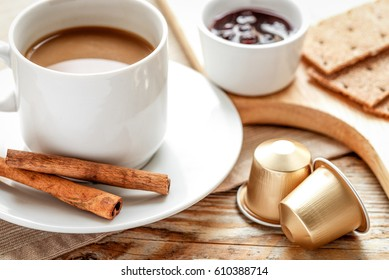 Breakfast with coffee and croissants on wooden table